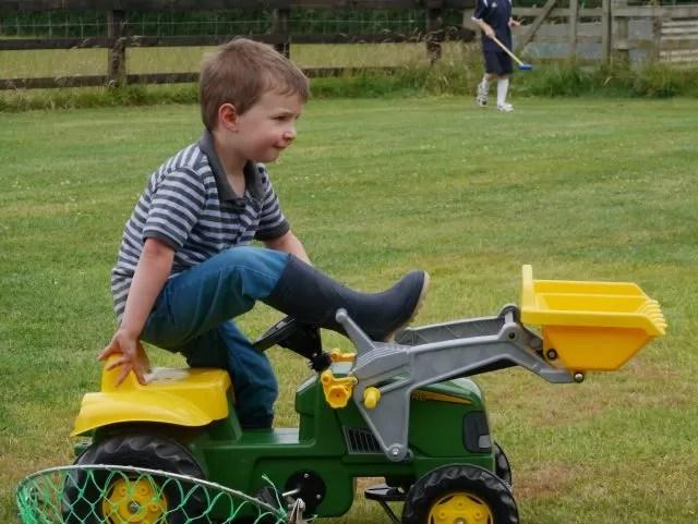 sitting on his John Deere tractor