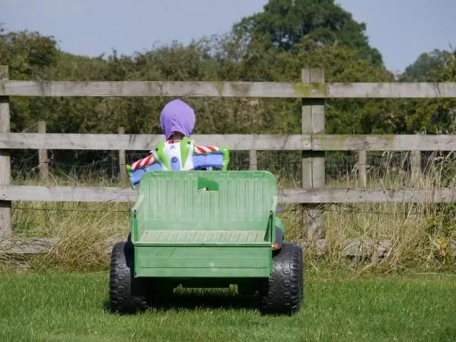 Buzz lightyear driving a gator