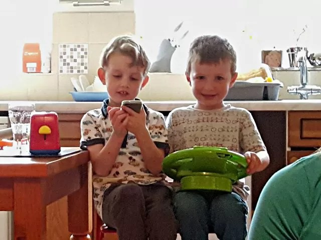 best friends playing cars