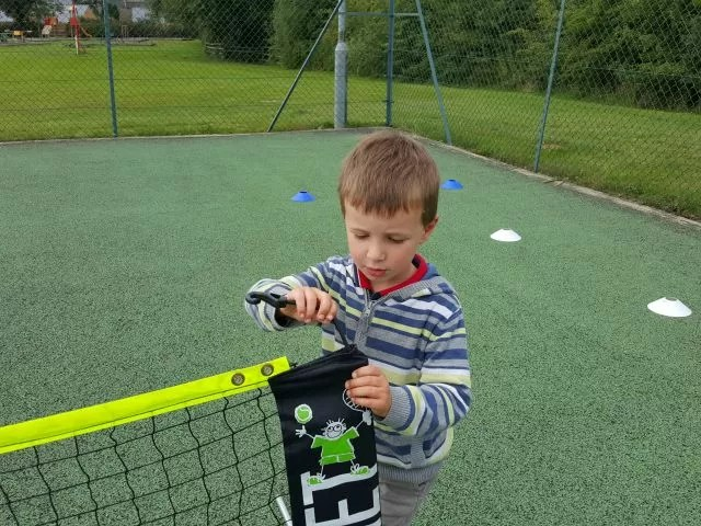 fiddling with the tennis net