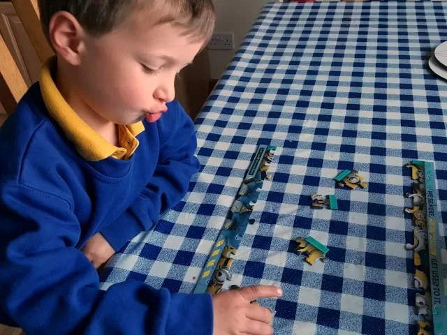 doing Minions jigsaw puzzle