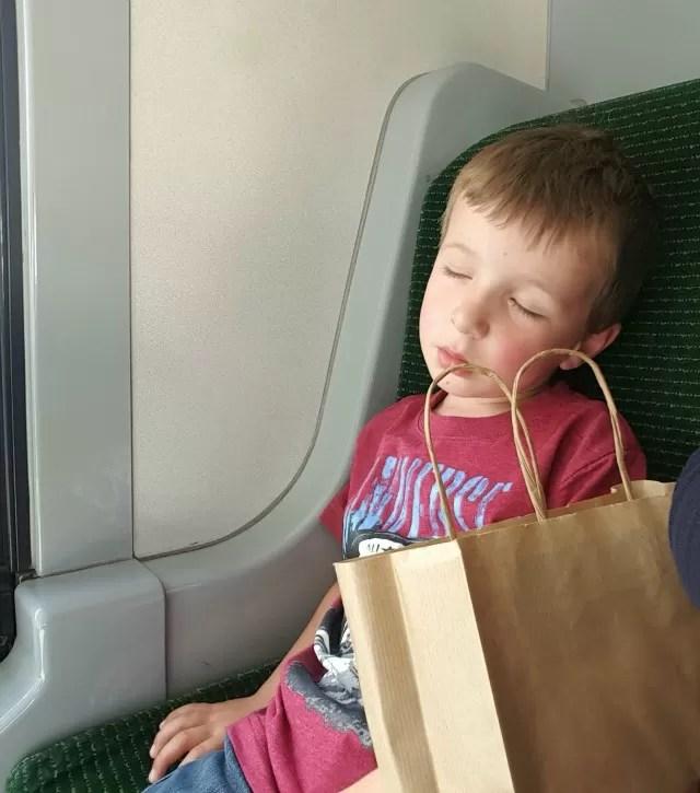 sleeping boy on the bus