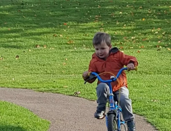 taking the corner on his bike