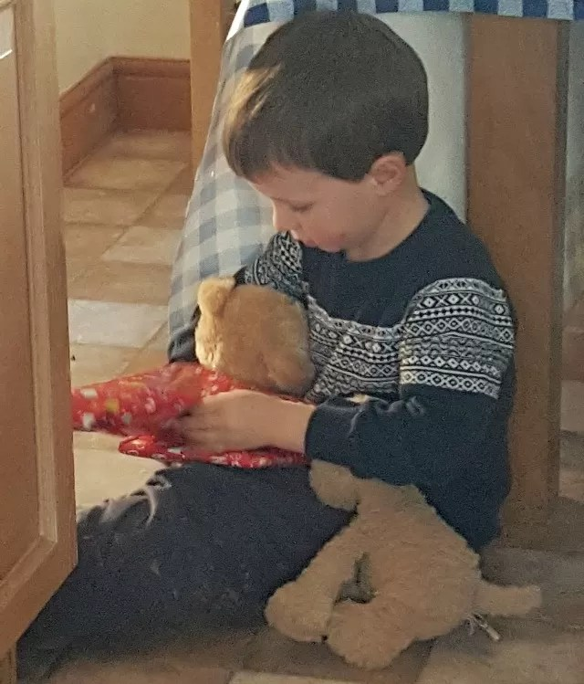 playing christmas pass the parcel with teddies