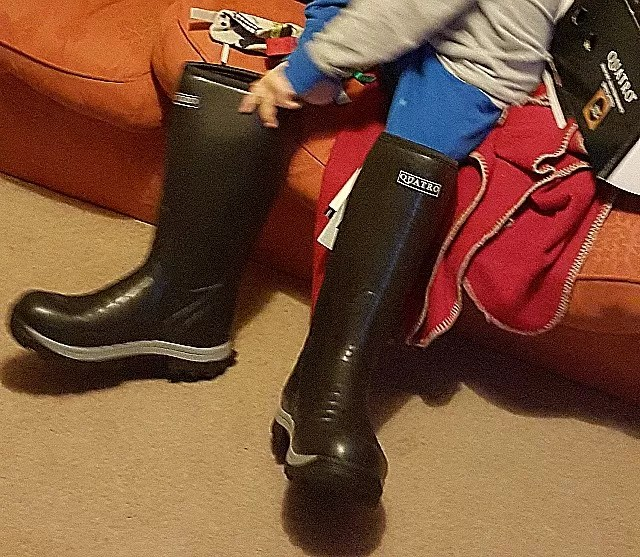 trying on uncle's wellies