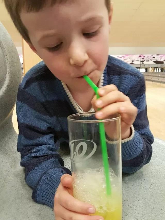 blowing bubbles in orange juice