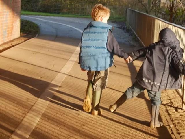 cousins holding hands - best friends