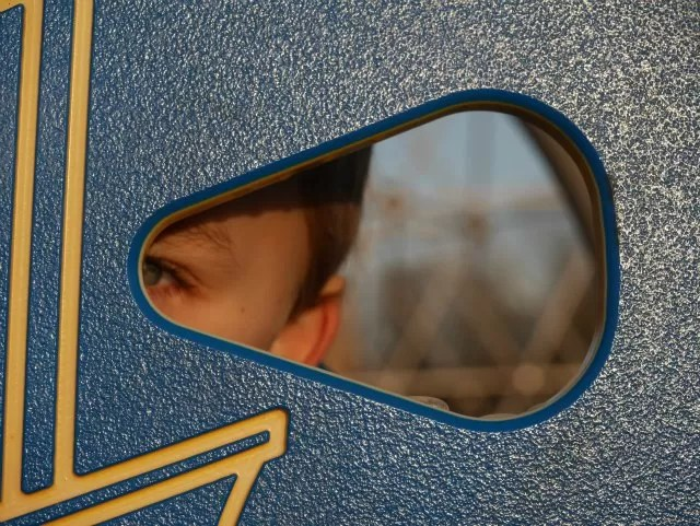 looking through the hole at the playground