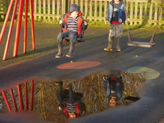 swing puddle reflections at the park