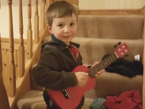 Playing his ukelele - Bubbablue and me Music Exploration