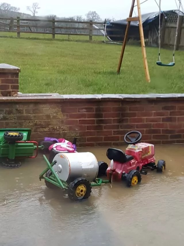 flooded patio with ride on tractor and food tanker