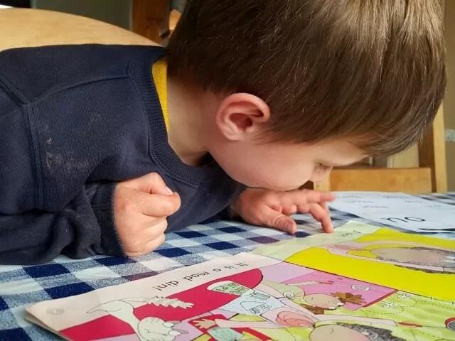 Reading his school book - Bubbablueandme