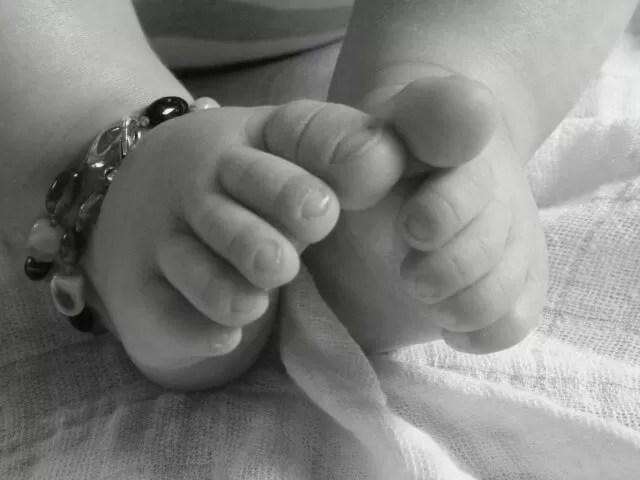 baby feet black and white