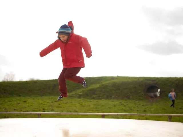 jumping on the bouncy pillow at Green Dragon eco farm