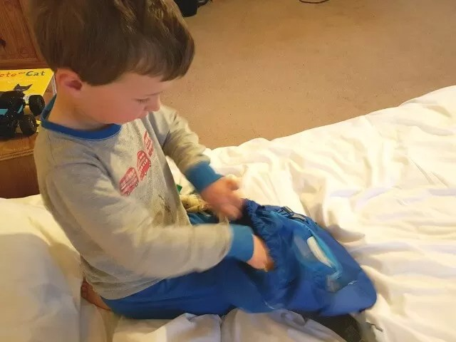 packing his little life rucksack