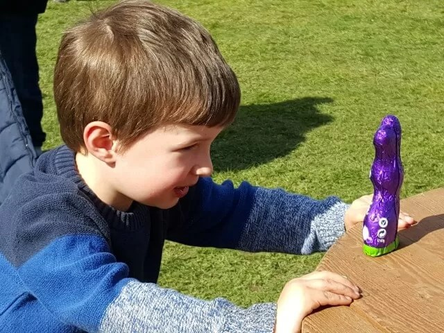 checking out his cadbury chocolate bunny