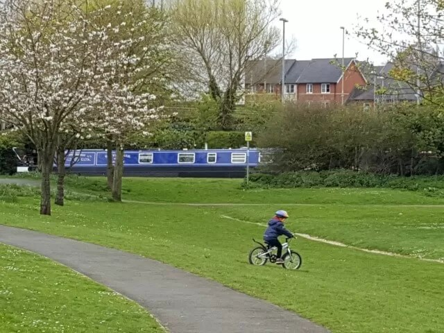 cycling downhill in spiceball park by Banbury canal