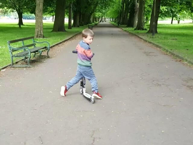 Scooting in Stretford with his micro scooter