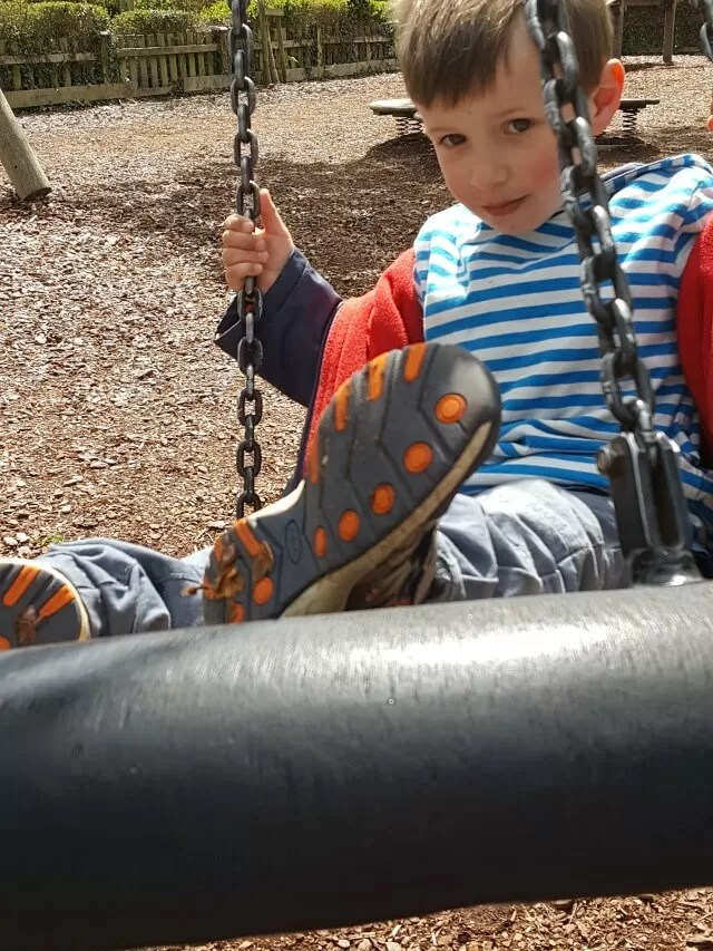 swinging at the Henley on Thames playground