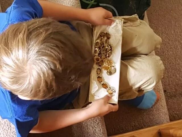 playing with treasure jewellery