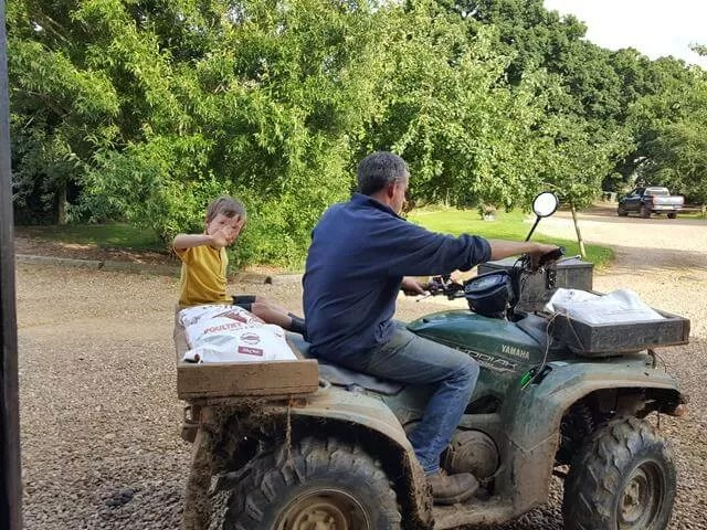 riding with his dad on the quad bike