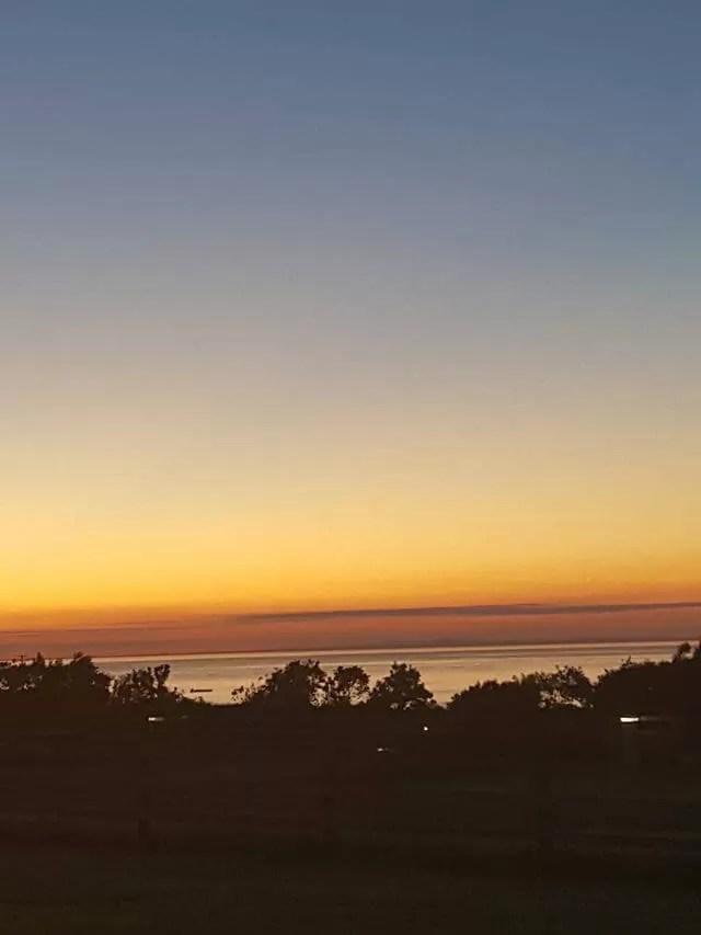 sunset over warcombe farm campsite in Devon