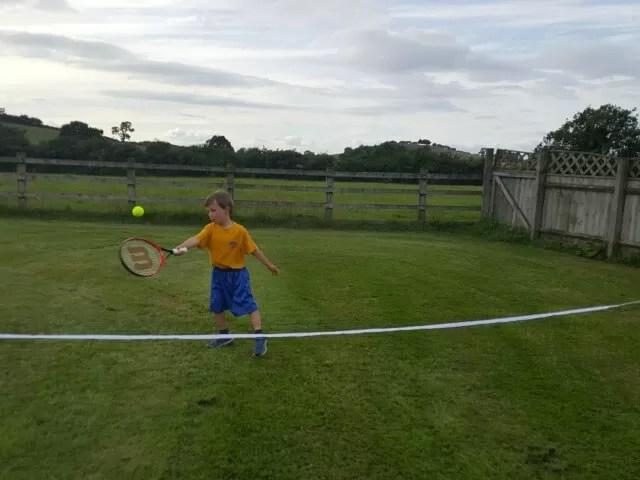 playing tennis int he garden