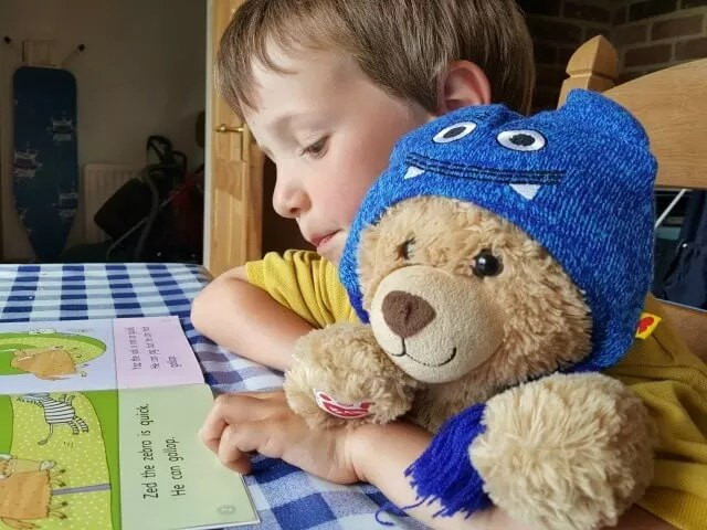 reading a school reading book with teddy