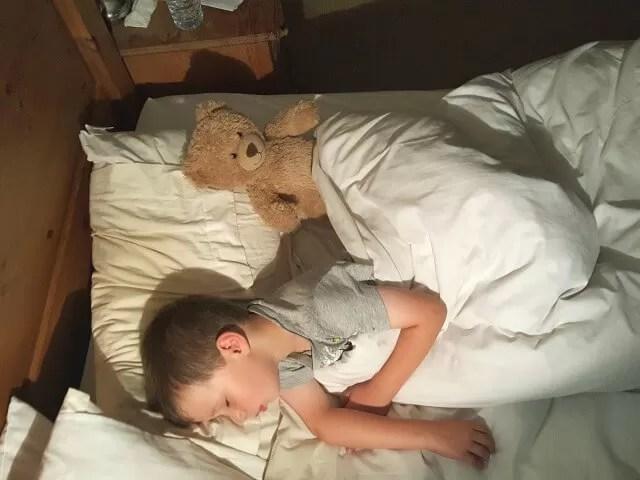 sleeping 5 year old with teddy bear