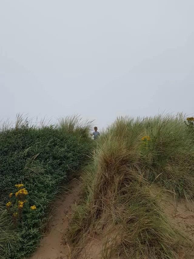 climbing the woolacombe sand dunes