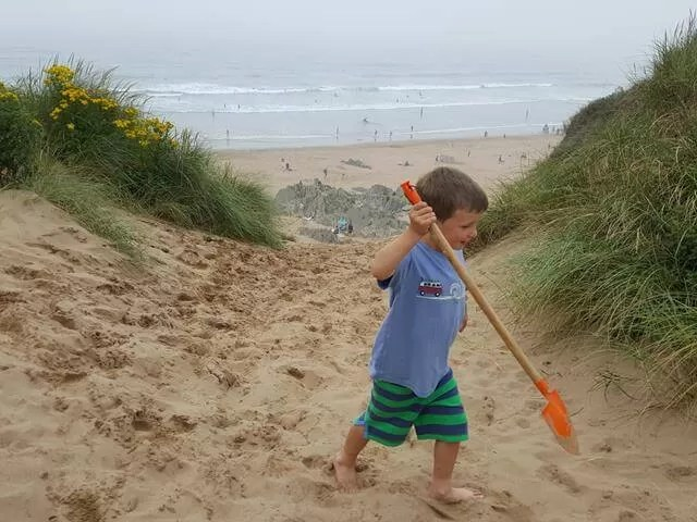 playing at the top of sand dunes