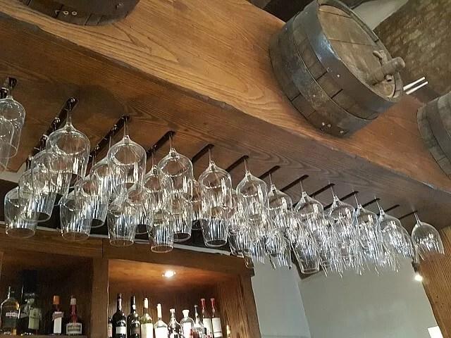wine glasses above a bar