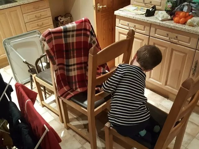 making a toy train from chairs