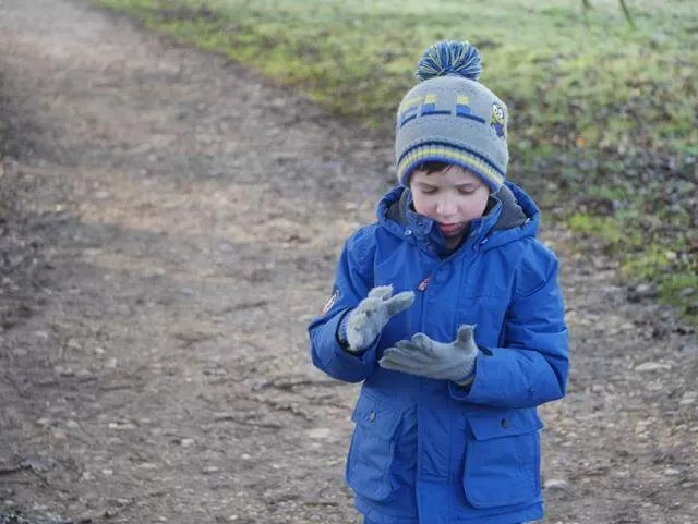 checking out little stones and wet gloves