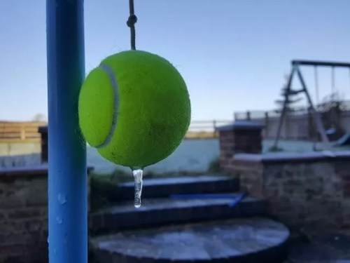 frozen tennis ball and swingball in the garden