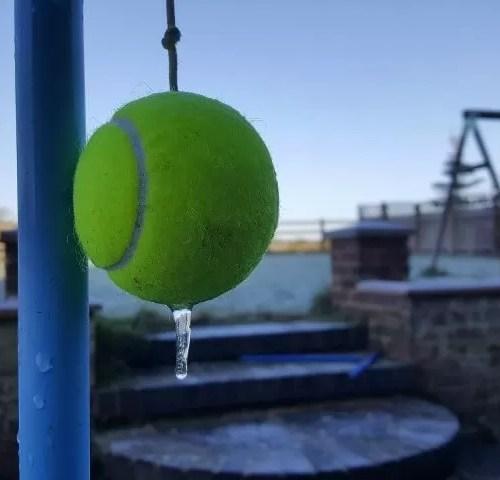 frozen tennis ball and swingball in the garden