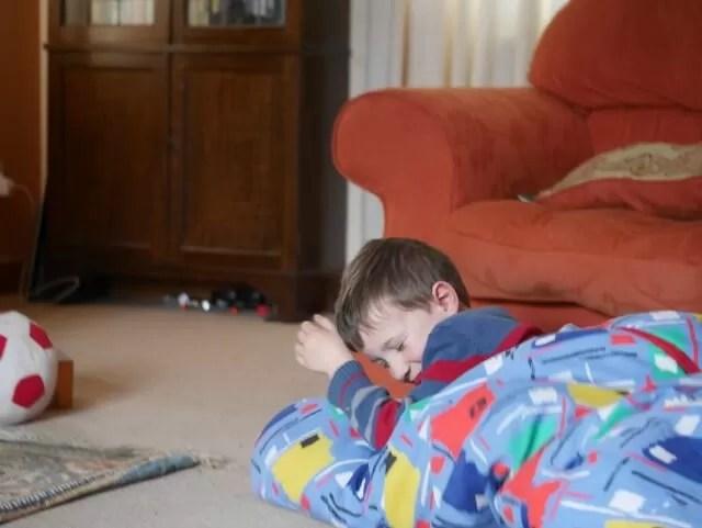 playing in his sleeping bag