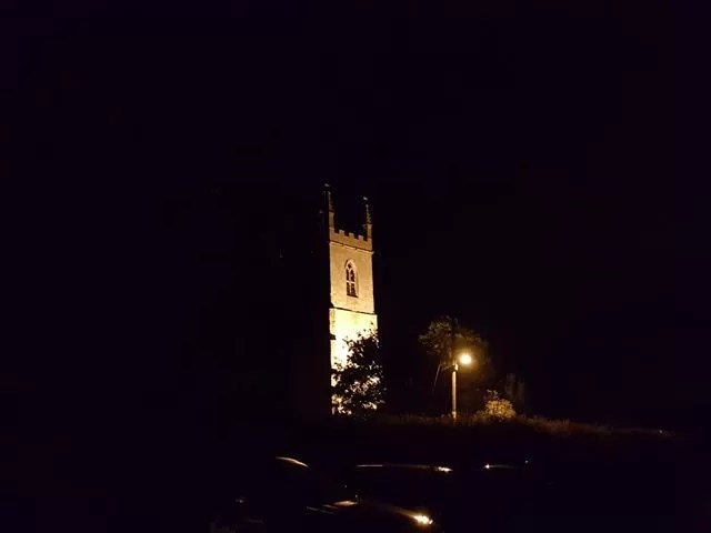 Islip church at night