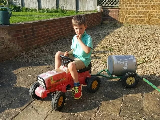 riding a too small tractor