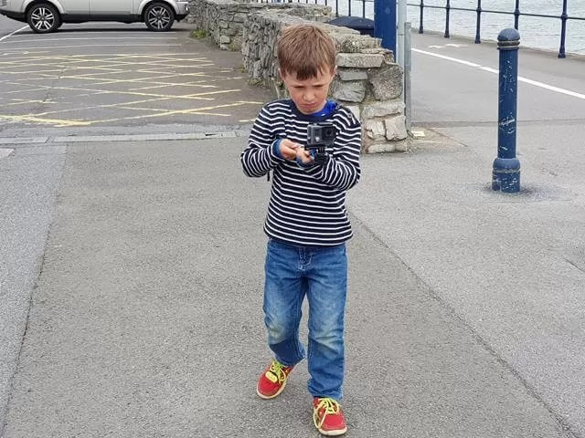 child with a go pro camera