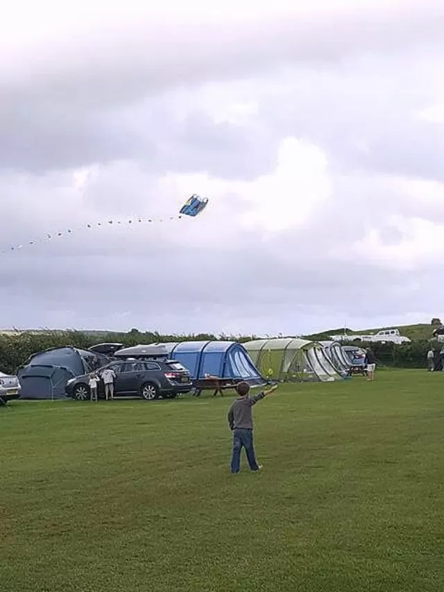 kite flying at 3 cliffs bay campsite