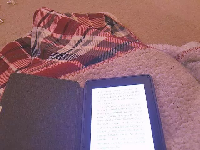 autumn time with kindle and blanket