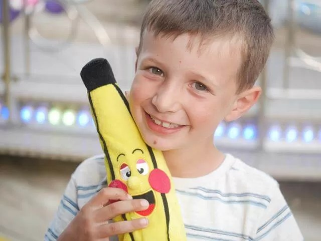 Happy with his toy banana win from the fair