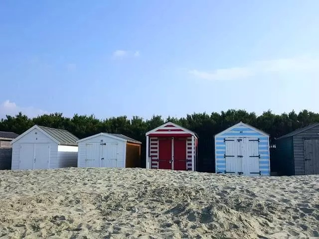 beach huts at top of west wittering beach