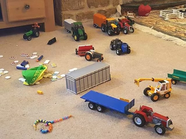 farm toys strewn on carpet