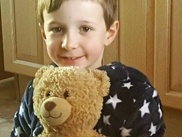 cute with his teddy bear