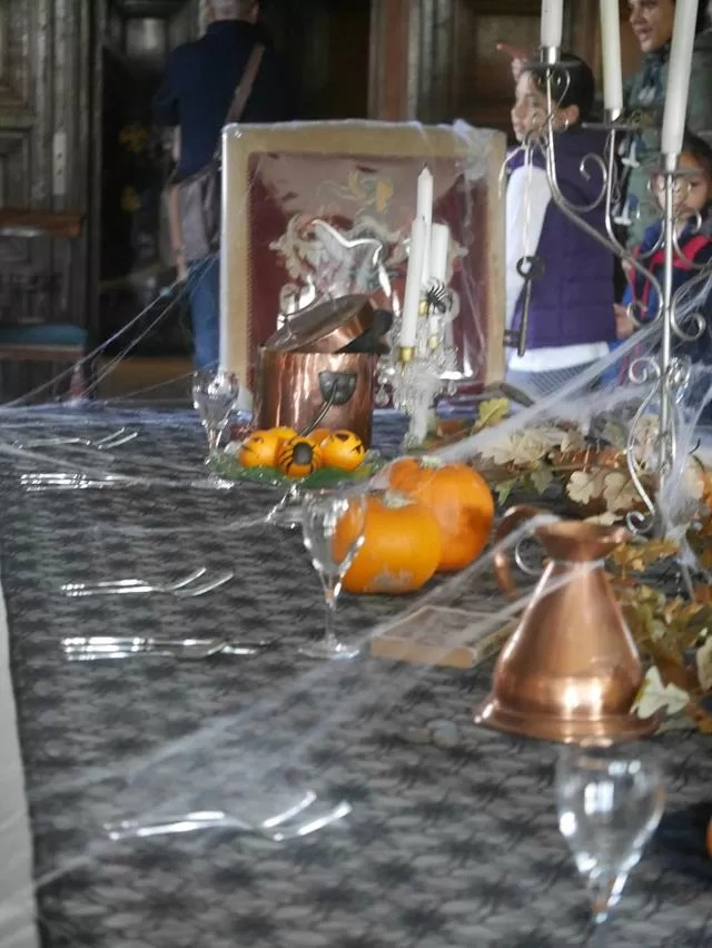 halloween display on tables at coughton court.
