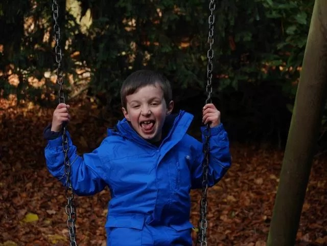 pulling faces onthe swings