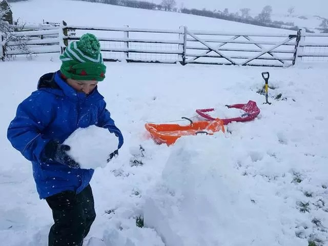 putting head on the snowman
