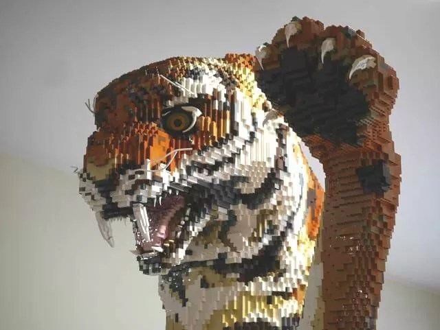giant lego tiger taking a swipe